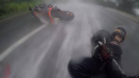 Biker Saves Girlfriend During Crash In Rain